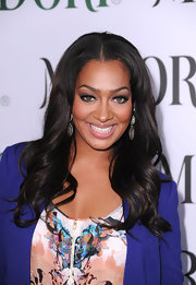 La La Anthony styled her hair in soft waves with a center part when she attended the launch of the Midori Trunk Shows.