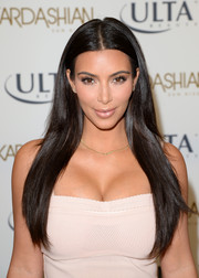 Kim Kardashian was promoting a self-tanning line but with that gorgeous, sleek hairstyle, she might as well have been on a shampoo commercial.