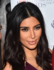 Kim Kardashian attended an Elizabeth Taylor AIDS Foundation event rocking a nude lip.