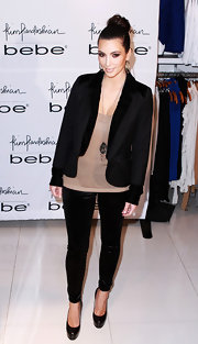 Kim Kardashian looked practically casual in timeless black leather pumps. She paired the heels with velvet leggings and a sophisticated blazer at the Bebe jewelry launch.