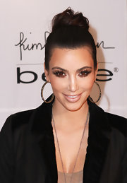Kim did a nice job of highlighting her bronze hoop earrings with a sleek bun, while attending the launch of the Kardashian jewelry line for Bebe.