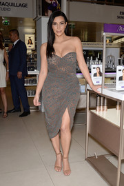 Kim Kardashian teamed her seductive dress with nude suede ankle-strap sandals by Alexander Wang.