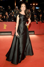 Andie MacDowell was a classic beauty in a black ruffle-neckline gown by Alberta Ferretti Limited Edition at the Berlinale premiere of 'The Kindness of Strangers.'