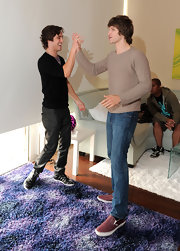 Keegan Allen was spotted at the launch party fo Kinect Xbox 360 wearing a pair of canvas shoes.
