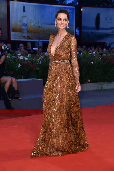 Kasia Smutniak made a diva-ish entrance in a printed gown with a plunging neckline at the Kineo Diamanti Award ceremony during the Venice Film Festival.