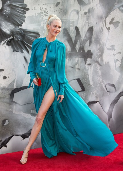 Poppy Delevingne showed off her endless legs and elegant gold heels at the London premiere of 'King Arthur: Legend of the Sword.'