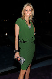 Nadja Swarovski glammed up her green jersey dress with some serious statement accessories.