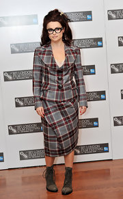 Helena paired her suede ankle boots with a checkered skirt suit and retro shades.