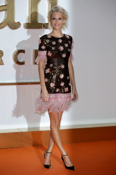 Poppy Delevingne looked ultra feminine in a beaded and feathered cocktail dress by Chanel at the world premiere of 'Kingsman: The Golden Circle.'