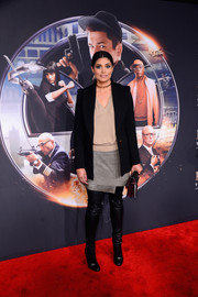 Rachel Roy donned a silver wraparound mini skirt with a nude knit top for the 'Kingsman: The Secret Service' premiere.
