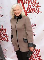 Glenn Close chose this stylish and chic brown coat with leather trim for her sleek and sophisticated red carpet look.