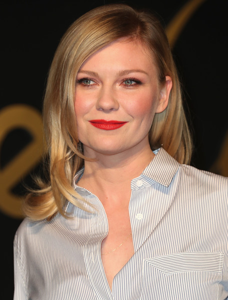 Kirsten Dunst Red Lipstick [hair,face,blond,hairstyle,lip,eyebrow,chin,beauty,layered hair,long hair,kirsten dunst,arrivals,la,california,panthere de cartier party,milk studios]