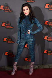 Charli XCX looked sexy even without showing any skin in this skintight tiger-print turtleneck by Kenzo x H&M during the Kiss FM Haunted House Party.