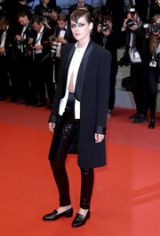Kristen Stewart layered a Chanel tuxedo coat over a split blouse for the Cannes Film Festival screening of 'Knife + Heart.'