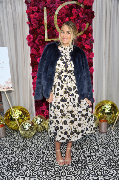 Lauren Conrad styled her floral dress with a navy fur coat for the Girls' Night Out party.