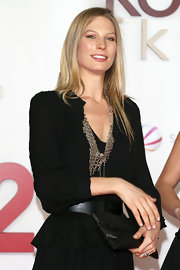 Sarah Brander dressed up her subdued LBD with an ornate gold statement necklace at the 'Kokowaeaeh 2' premiere.