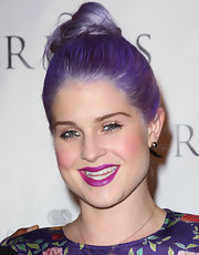 Kelly Osbourne swept on an iridescent violet lipstick to complement her brightly tinted tresses and boldly patterned frock.
