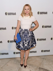 Kristen Bell paired her top with a flared blue and white abstract-print skirt by Alexander McQueen for a more sophisticated finish.