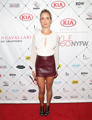 Kristin Cavallari contrasted her blouse with a sexy burgundy leather mini by Michelle Mason.