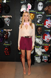 Kristin Cavallari paired pointy-toe nude pumps with her cute pink wrap top and burgundy shorts combo.