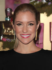 Reality star Kristin Cavallari added a subtle touch of sparkle to her look with a golden-peach shadow completed with heavily lined eyes.