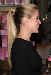 Kristin Cavallari showed off a long sleek ponytail at the Juicy Couture launch. She finished her look by wrapping pieces of hair around the base of her pony.