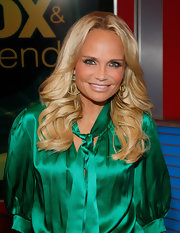 Kristin Chenoweth visited 'FOX & Friends' with long, wavy locks. To try Kristen's look at home, curl two-inch sections of hair with a large-barreled curling iron and curl tresses away from the face. To finish, tousle curls with fingers and mist with sheer hold hairspray.