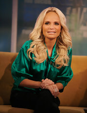 Kristen Chenoweth wore a pair of large mobile earrings in 18-carat gold while visiting 'FOX & Friends' at FOX studios