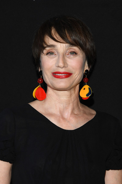 Kristin Scott Thomas Bowl Cut [hair,face,hairstyle,lip,yellow,beauty,chin,nose,orange,cheek,prive haute couture fall winter 2018,giorgio armani,kristin scott thomas,prive,front row,part,paris,france,paris fashion week,show]