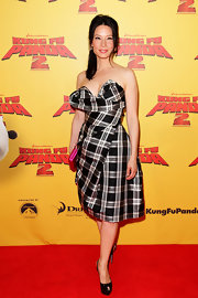 Lucy Liu was perfectly stylish at the 'Kung Fu Panda 2' premiere in a plaid cocktail dress with a dramatic bust that is signature Vivienne Westwood.
