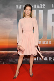 Lea Seydoux kept it sweet and modest in a long-sleeve pink cocktail dress by Louis Vuitton at the Paris premiere of 'Kursk.'