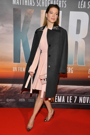 Lea Seydoux arrived for the Paris premiere of 'Kursk' wearing a charcoal Louis Vuitton coat with an embroidered collar.