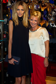 Anja Rubik paired a modern studded zip-around clutch with her timeless LBD at the Everything but the Dress launch party.