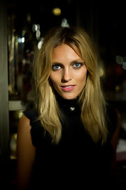 Anja Rubik hit the Everything but the Dress launch party sporting a messy center-parted layered cut.