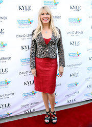 Lisa Gastineau chose a fitted red dress to pair under the leopard-print blazer for a big and bold red carpet look.