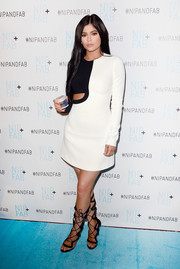 Kylie Jenner looked mod in a black-and-white David Koma cutout dress during her presentation as brand ambassador for Nip + Fab.