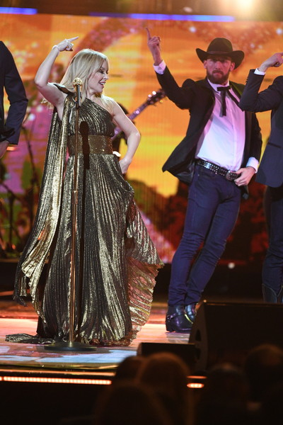 Kylie Minogue One Shoulder Dress [image,entertainment,performing arts,dance,performance,event,dancer,fashion,dancesport,stage,performance art,queen,hm queen elizabeth ii,members,tom jones,london,united kingdom,royal commonwealth society,picture agency,birthday party]