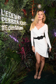 Petra Nemcova kept it sophisticated in a figure-hugging white wrap dress at the L'Eden by Perrier-Jouet opening.