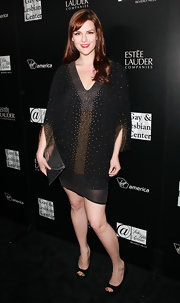 Sara Rue modernized her sexy mini dress with a silver envelope clutch.