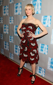 Renee struck a pose in a strapless appliqued red, white and black, velvet, floral cocktail dress with a tulle-trimmed neckline.
