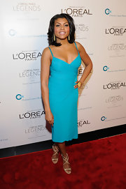 Taraji P. Henson topped off her bright turquoise dress with nude strappy sandals.
