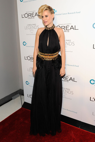 Aimee Mullins wore a black halter gown with gold accents and feather embellishments for the L'Oreal Ovarian Cancer Research benefit.