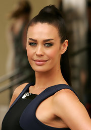 Megan Gale sported a sleek high ponytail when she attended the L'Oreal Melbourne Fashion Festival program launch.