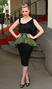 You can't help but love Melissa's quirky yet stylish embroidered cocktail dress with a green ruffle at the Melbourne Fashion Festival.