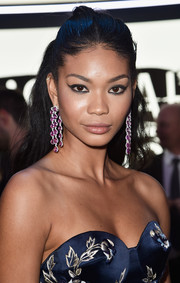 Chanel Iman pulled her hair back into a simple half-up style for the L'Oreal Paris Blue Obsession party.