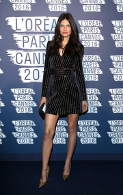Bianca Balti was sharp and chic in a black tuxedo dress with metallic pinstripes at the L'Oreal Paris Blue Obsession party.