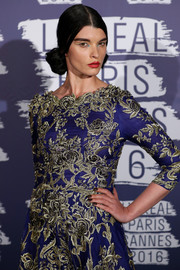 Crystal Renn paired a dark mani with an intricately embroidered purple gown for the Blue Obsession party.