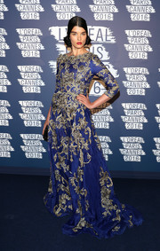 Crystal Renn went for old-school glamour in this floral-embroidered gown by Marchesa during the L'Oreal Paris Blue Obsession party.