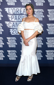 Ulyana Sergeenko made an appearance at the L'Oreal Paris Blue Obsession party wearing a white cold-shoulder crop-top with puffed sleeves.