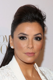 Eva Longoria sported a punk-glam half-up pompadour at the Women of Worth celebration.
